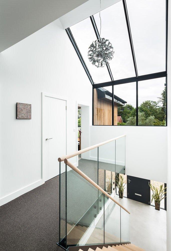 Dettaglio Parapetto in legno e vetro- scala per interni in legno e metallo